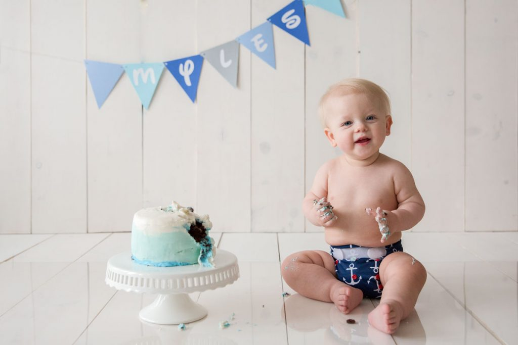 Lexington, KY baby photographer picture of baby boy with a blue cake smash cake