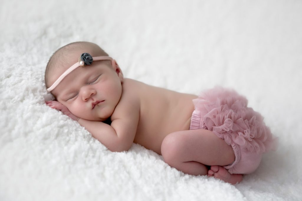 Lexington, KY baby photographer picture of newborn wearing ruffled bloomers in pink