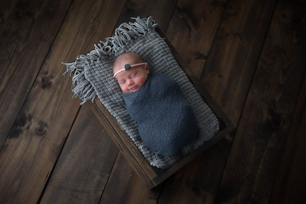 Harrodsburg, KY newborn photographer picture of baby wrapped and inside a wooden crate