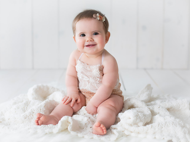 Harrodsburg, KY newborn photographer picture of a 6 month old sitting on a white blanket