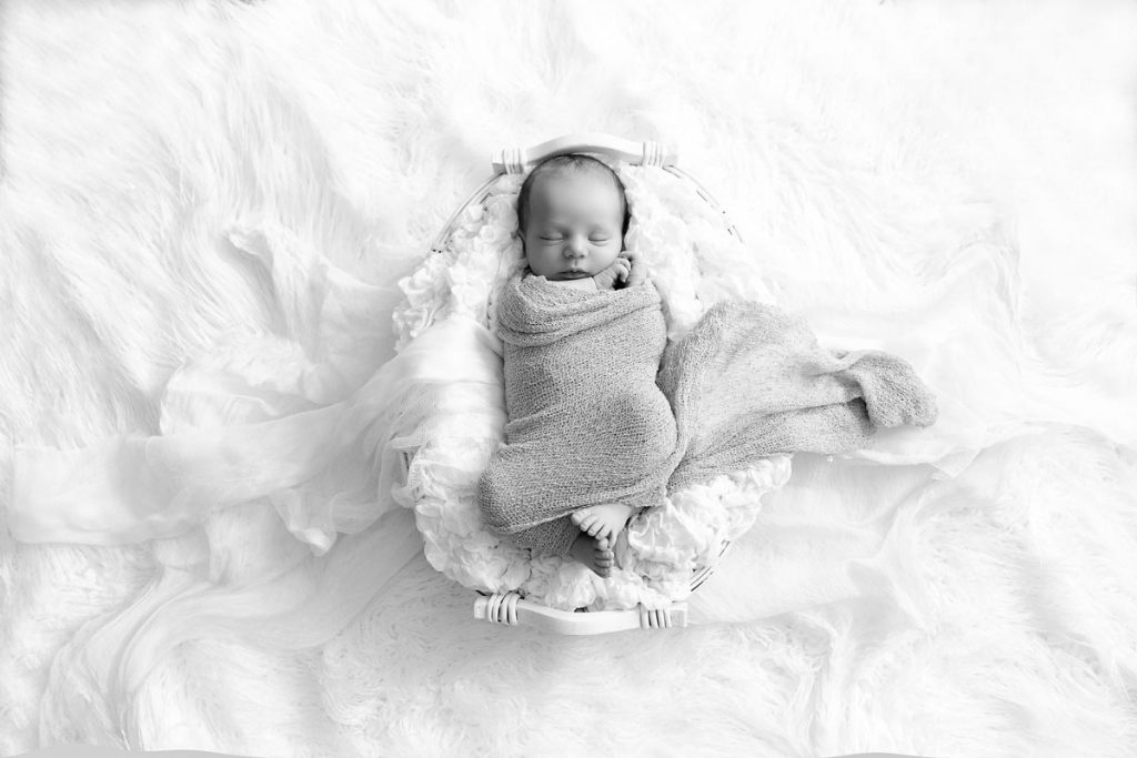 Lexington, KY newborn photographer picture of wrapped baby in basket, black and white picture