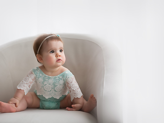 Lexington, KY newborn photographer of baby in lace sitting in a chair