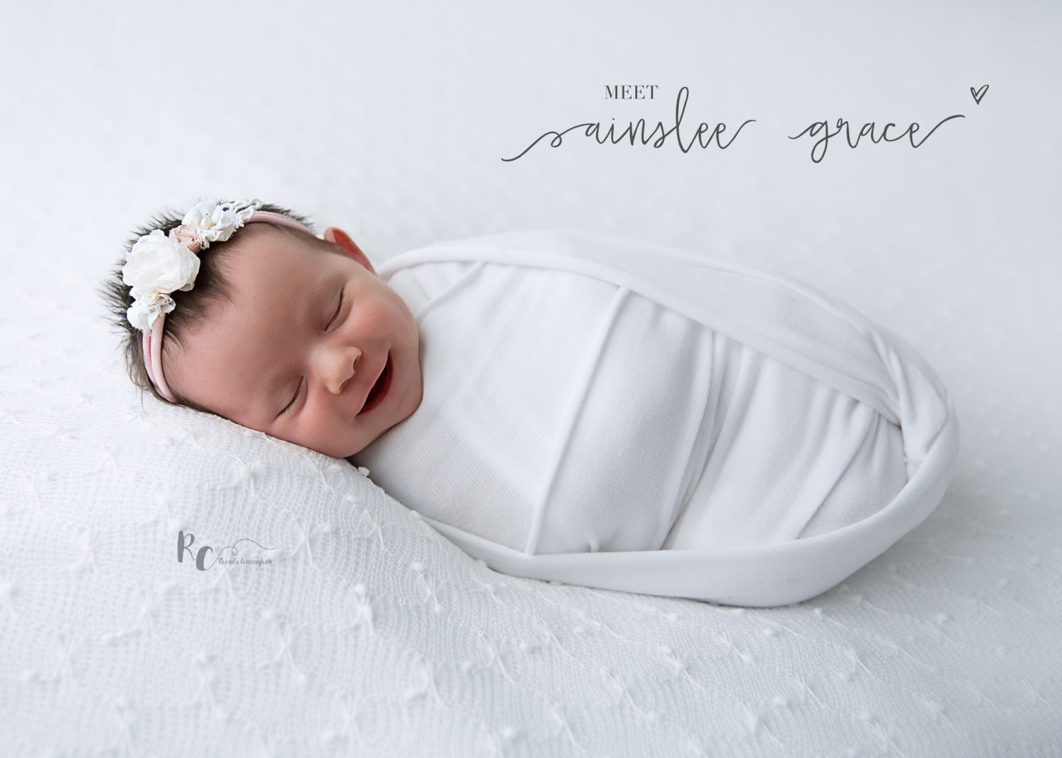Newborn baby swaddled and smiling in an image captured by Rhonda Cunningham, Newborn Photographer in Lexington, KY