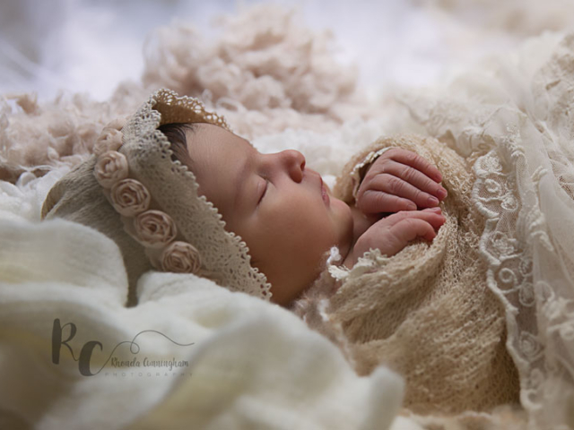 Lexington, KY Newborn Pictures of Newborn baby in vintage bonnet