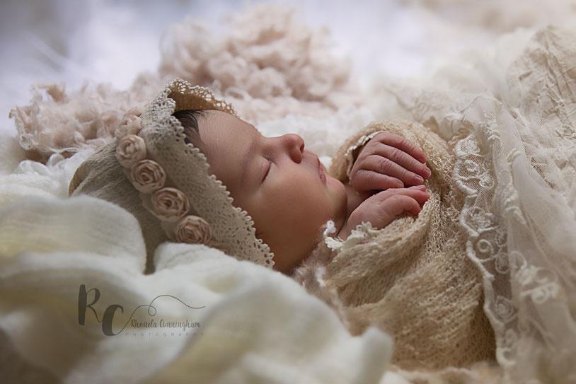 Lexington, KY Newborn Pictures of Newborn baby in vintage bonnet