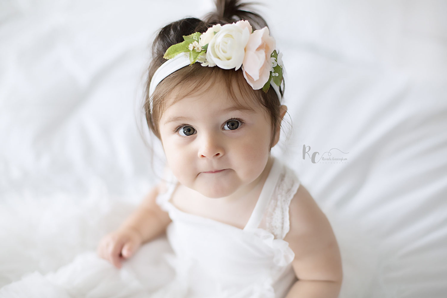 One year old baby girl all in white during one year portrait session captured by Lexington, Ky photographer, Rhonda Cunningham Photography.