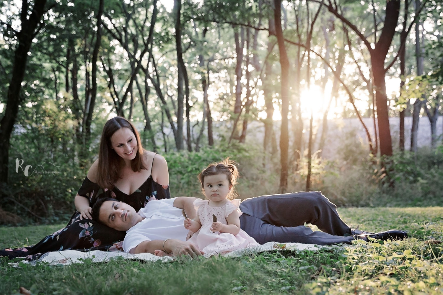 One year Portrait Session of family with sun setting in the background captured by Rhonda Cunningham Photography, a Lexington, Ky Photographer.