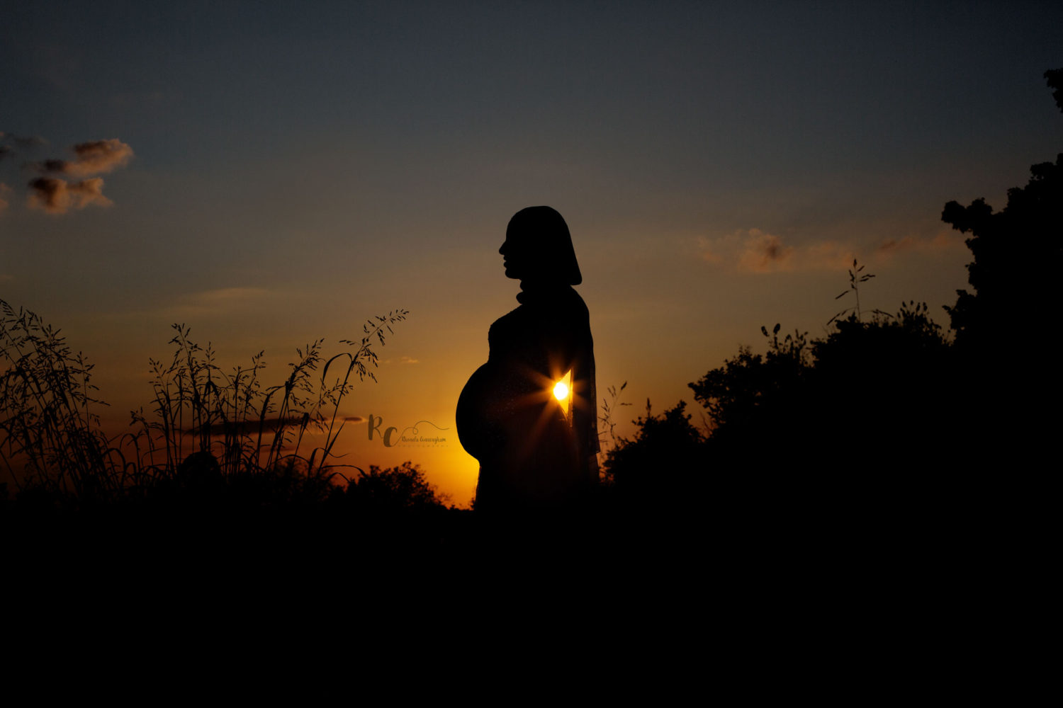 Silhouette Image of pregnant mother at sunset captured by Lexington, KY Maternity Photographer, Rhonda Cunningham Photography.
