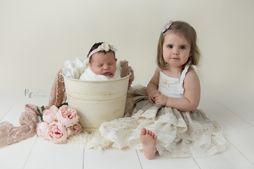 Sibling portrait of big sis and newborn sister by Lexington, KY newborn photographer Rhonda Cunningham Photography
