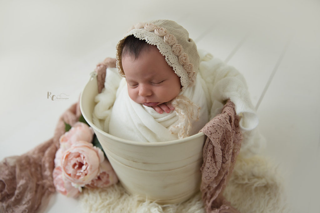 Newborn portrait of baby in a vitage shabby chic bucket by Rhonda Cunningham Photography, Lexington Ky newborn photographer